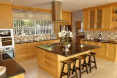 Open plan kitchen with lots of cupboards