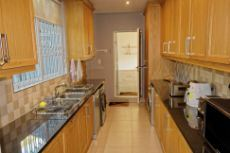 Scullery/Laundry with loads of cupboards