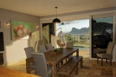 Dining area with built-in braai and access to pool
