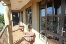 Balcony with views into nearby green area