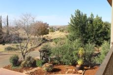 Nearby green area with hiking trail to Administrative Office, tennis courts and outdoor gym