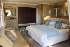 Main bedroom with semi-open plan bathroom