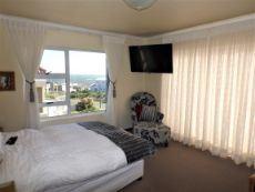 1st Floor: Main en suite Bedr (bath & shower); own Balcony. View.