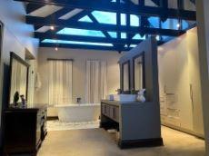 Open-plan bathroom with built-in cupboards