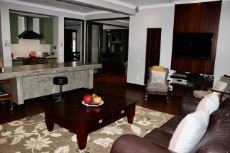Family room and kitchen with access to dining room and entertainment area