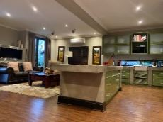 Open-plan kitchen and family room viewed from entertainment area (taken with wide angle lense)