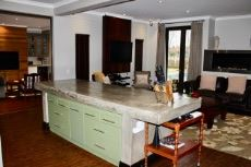 Kitchen and family room with view into entertainment area