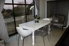 Open-plan dining area next to picture window.