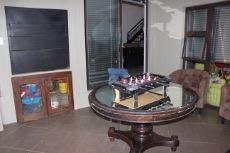 Enclosed braai area with folding doors to pool