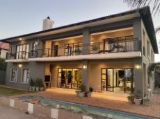 Easter facade featuring built-in braai and pool