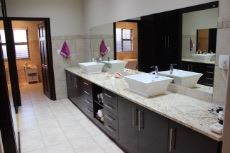 Dressing room with his and hers basins