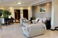 Open-plan family room with sliding door to patio with built-in braai