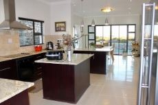 Open-plan kitchen and dining area with sliding door to patio