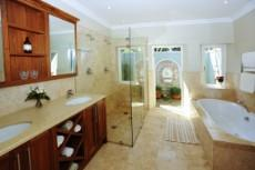 Full bathroom and outside shower courtyard.