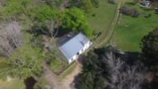 Aerial of barn and surrounding paddocks.