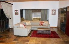 Lounge with fireplace and sliding doors to enclosed entertainment area