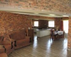 Living area with kitchen in background